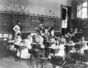 Image result for photos of bolted down desks in 19th century classrooms
